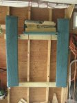 cradle stored on garage wall.jpg